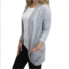 Grey cardigan Super cute grey cardigan with pockets! Material is 100% Cotton. Item is true to size and relaxed fit. Perfect for the transition into Spring! Relished Sweaters Cardigans