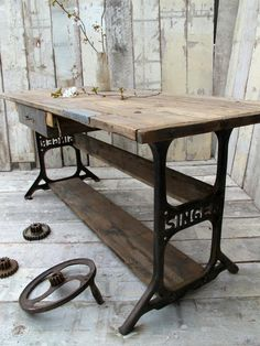rustic table top with recycled legs from sewing machine.