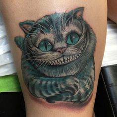 "The Cheshire Cat tattoo unfolds the famous story of ""Alice in Wonderland"". top 35 best cheshire cat tattoo design with meaning collection 2018 Dog Tattoos, Animal Tattoos, Body Art Tattoos, Tattoo Cat, Cheshire Cat Tattoo, Chesire Cat, Cat Tattoo Designs, Tattoo Designs And Meanings, Disney Tattoos"