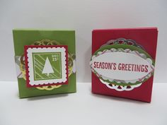 Stampin' Up Tag/Ornamnet Holder Boxes with tags/ornaments made by Lynn Gauthier using SU's Note Tag and Snow Flurry Punches, SU's Merry Moments DSP, SU's Tags & Labels Framelits, and SU's Lots of Joy, Antique Tags and Peaceful Pines Stamp Sets. Go to http://lynnslocker.blogspot.com/2015/12/stampin-up-merry-moments-antique.html for instructions on how to make this project!