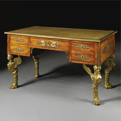 A FINE EMPIRE STYLE GILT-BRONZE MOUNTED FLAME FIGURED MAHOGANY BUREAU PLAT<br>FRENCH, CIRCA 1890 | lot | Sotheby's