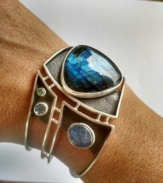 "Tammy B. Jewelry | ""Midnight"" cuff. Sterling, labradorite, kyanite, topaz, and emerald."