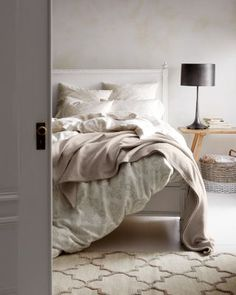 Romantic florals in a tempting blend of washed linen and cotton set a tranquil scene. With quiet colors, this bed-of-roses print is as easy to decorate with as many solids.