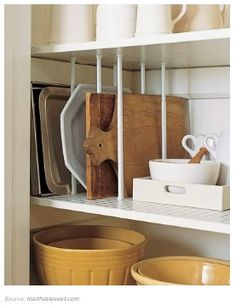 Use tension curtain rods to create a rack for cookie sheets, cutting boards, etc. Easy to move or expand space as needed.