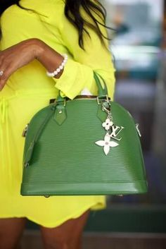 Color combo and her skintone= perfection. Louis Vuitton . I've got to dup this look