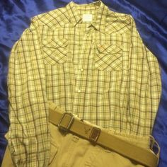 Hollister size medium men's button up shirt Hollister size medium men's shirt 100% cotton green beige brown and blue and white pattern snaps are on front of shirt sleeves and pockets left pocket has orange Hollister bird. Shorts and belt not included Hollister Tops Button Down Shirts