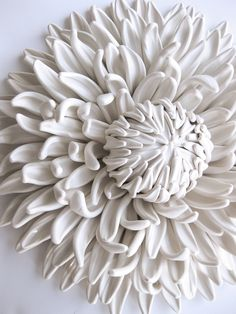 Angela Schwer works out of her living room, creating spectacular dahlias, poppies, fungi, and even creatures from polymer clay. The handmade pieces are meant to be used for decoration and feature incredible detail. Each piece is an assemblage of several smaller, equally detailed parts, coming together to form a pure white sculpture ready to hang in a living room or art studio.