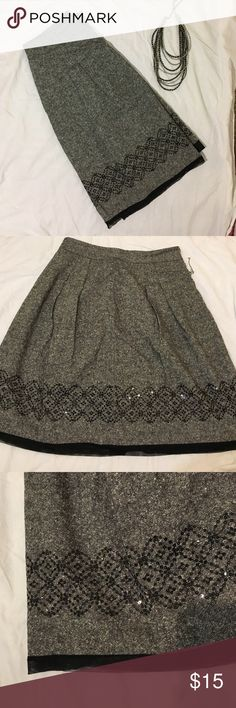 Wool skirt with sequin design Wool grey/black skirt with built in liner and side zipper closure. Sheer tulle-like trim and sequined design along the bottom edge. LOFT Skirts Midi
