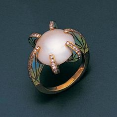 A pearl, enamel and diamond ring  The central bouton pearl within a six-claw setting, each millegrain-set with single-cut diamonds, the shank and shoulders enamelled with stylised foliate motifs, two claws are hinged, pearl untested. Art Nouveau?