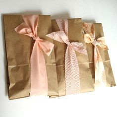 ribbons around paper bags