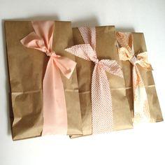ribbons around paper bags
