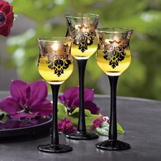 A romantic damask motif and midnight black stems add drama to our curvy glass candle holders. For use with a votive or tealight candle SHOP ONLINE at http://www.partylite.biz/legacy/sites/nikkihendrix/productcatalog?page=productdetail&sku=P91307&categoryId=58051&showCrumbs=true wedding, centerpiece, bedroom decor, black elegant, trio, bridal, candles, yellow, flowers, tablescape