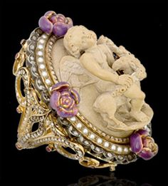 Stunning Lava stone cameo, yellow gold and silver, white and brown diamonds, and enamel ring by Lydia Courteille.