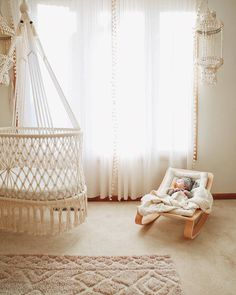 Hanging Crib in Macrame in Cream (hand-woven wicker base) hanging Bassinet – handwoven base detail, wood baby rocker, anthropologie sheer curtains, neutral nursery for baby – studio picture