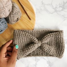 Put your Tunisian crochet skills to good use and make a customizable headband! This free Tunisian crochet headband pattern is easy enough for beginners. Crochet Ear Warmer Pattern, Crochet Headband Pattern, Crochet Patterns, Tunisian Crochet, Crochet For Beginners, Ear Warmers, Crochet Bikini, Pattern Design, Crochet Pattern