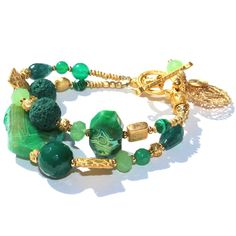 """Double Gemstone Waterfall BraceletWe can't help but feel like we've found the famous """"X"""" with this treasurable bracelet. The exotic and regal design radiates in gleaming gold and glorious jade. Vivid gemstones, beautiful cuts of agate and craters of hardened lava sing on this darling design. $149, free global shipping http://www.luka.com.au/shop/double-gemstone-waterfall-bracelet-green-gold/"""