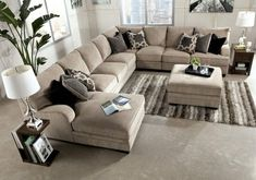 Furniture. Cream Upholstered Sectional Sofa With Chaise And Cushion Plus Ottoman Coffee Table Added Brown Wooden Side Table With White Lamp. Appealing Extra Large Sectional Sofas Bring Comfort Zone Into The Room