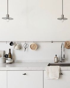 apartment kitchen in neutral hues with marble counters and stainless steel accen Minimalist Kitchen accen Apartment counters hues Kitchen marble Neutral stainless steel Design Jobs, Küchen Design, Home Design, Design Ideas, Design Styles, Layout Design, Decor Styles, Rustic Kitchen Design, Interior Design Kitchen
