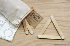 Shape sticks with printable shapes to make.  Just need craft sticks with velcro.