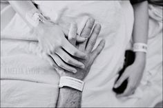 Mom & Dad holding hands at a pivotal moment...Either during labor, or perhaps waiting to hold their baby!