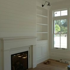 Fireplace with flanking  cabinetry