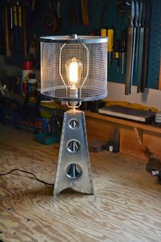 Fabrication methods: buck riveting solid aluminum rivets, using box and pan brake to bend the aluminum sheet, and punch flared holes. A simple drum lampshade was made from aluminum and galvanized mesh. There is also a really nice chair! Here #DeskLamp, #RecycledLamp #Aerospace, #Design, #DIY, #Handmade, #Metal, #Steampunk, #Vintage @idlights