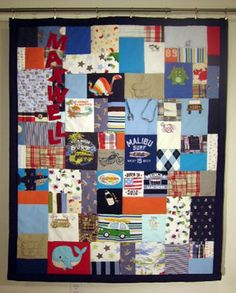 A quilt made from your kid's old clothes. AMAZING!! Definitely going to do this, along with donating and recycling to friends and those in need of course :)