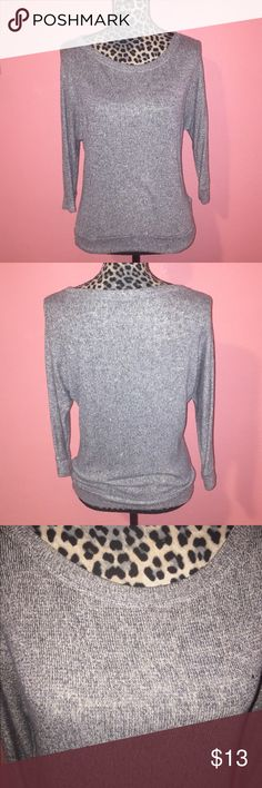 Forever 21 Metallic Grey Knit Dolman Sleeve Top S Gently used and in great condition, tunic top features dolman sleeves and is made of a grey knit with slight gold metallic yarns knitted into it. Great for the winter season. Size small. Forever 21 Tops Tunics