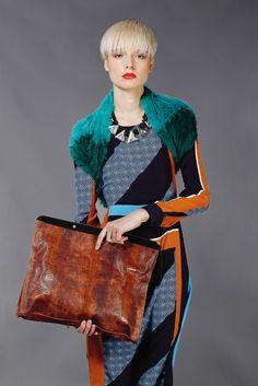 San & Soni's silk crepe dress. Jocelyn's fur scarf; Karla Deras for Roman Luxe necklace; Cynthia Vincent bag.