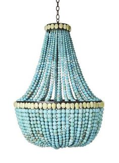 In a room of otherwise warm colors, this turquoise beaded chandelier by Marjorie Skouras stands out in its cool, vibrant hue