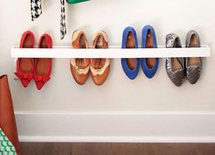 "DIY shoe storage using 1"" x 4"" wood strips."