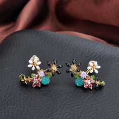 Buy Glamiz Rhinestone Flower Earrings at YesStyle.com! Quality products at remarkable prices. FREE Worldwide Shipping available!