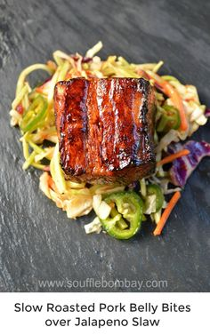 Slow Roasted Pork Belly Bites over Jalapeno Slaw More