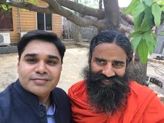 #yoga guru Baba Ramdev with prime time Anchor and Editor of Zee Business Amish Devgan.