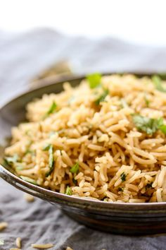 This Asian rice pilaf brings rice to a new level with it's wonderfully savory flavor and tastes amazing paired with grilled meats or fish. | lisasdinnertimedish.com Pork Rib Recipes, Side Dish Recipes, Asian Recipes, Rice Recipes, Asian Foods, Potato Recipes, Yummy Recipes, Healthy Recipes, Easy Rice Pilaf