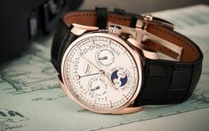 By Keith Bombrys    This beautiful, ultra-thin, round wristwatch is quite a stunning piece for any timekeeper's collection. The Parmigiani Tonda 1950 Annual Calendar is available in rose gold and white gold, both of which give this piece