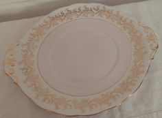 Stunning English Bone China baby pink and gold detail cake plate  In great condition, no chips or cracks. Made from English Bone China. Perfect to complete an afternoon tea set.  Please see my other items for more beautiful vintage tea sets.  I am happy to reduce postage costs for multiple items that are purchased, please convo me if you want to purchase more then one item and I can work out a combined cost.