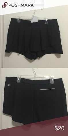 Skort Skort, Cognac, lightweight stretch woven fabric with bak lining, soft Jersey waistband, pockets at sides, reflective back welt pocket with zipper closure and pleaded wrap front. Never been used. Fabletics Shorts Skorts