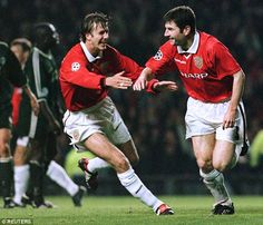 Denis Irwin (right) celebrates with David Beckham after scoring a penalty for…