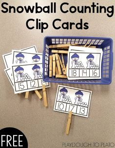 Snowball Counting Clip Cards! A fun way for kids to work on counting, number recognition and fine motor skills. Perfect for winter math centers with preschool and kindergarten kids! #playdoughtoplato #mathfreebies #wintermathcenters