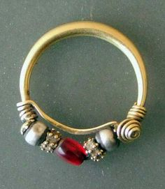 India | Nosering ~ 'nath' ~ gold, silver and glass.  From Gujarat | Price on request