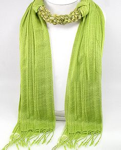 Hand sewned,the center of this soft light weight cotton scarf is adorned with tumbled semi precious Peridot nuggets.In ancient times this gemstone when worn was said to enhance,Relaxation, Comfort, Prosperity, Growth, Openness,health, wealth, sleep,vigor,recuperative abilities,comfort and intuition.Inspires healing, renewal, purification, rebirth and growth...Price $69.97