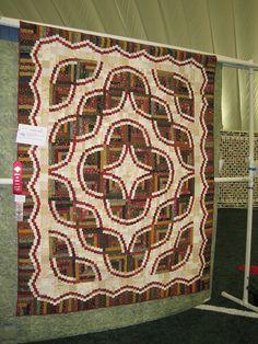 Snake River log cabin, Judy Martin pattern    Nancy Swezey: Curved Log Cabin by upstatelisa, via Flickr