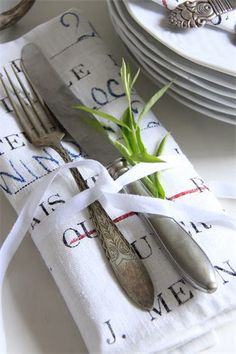 place setting...  This could be a unique way to personalize a small dinner party.  Use printable iron-on material...use quotes applicable to the party theme, names of those attending, or even the menu.
