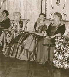 Princess Grace and Queen Victoria Eugenia of Spain attending a fashion at the Palace of Monaco, 1959.