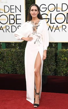2017 Golden Globes: Louise Roe is wearing a white Monique Lhuillier dress with a thigh high slit and silver embellishments. The dress is gorgeous!