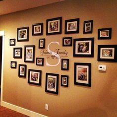 Family Picture wall: use thaw wooden letter K and vinal to write: Kimble family established 2007