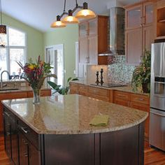 Kitchen inspiration. I did white cabinets on the perimeter, dark cabinets under island and this color granite.