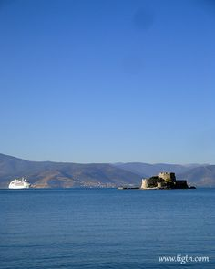 Mediterranean cruise ship in #Nafplio, anchored just off the entrance of the port facing #Bourtzi fortress, #Peloponnese - #Greece