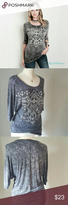 Tribal Print Top Soft, knit, tie dye!! Knit top has a tie dye effect, with a distressed tribal print graphic..  *Three-quarter dolman sleeve * Tribal Print graphic on tee, accented with gold, silver,  and gunmetal studs.  * Size down for a fitted look, or up for a looser, casual look.  * Colors vary by shirt so yours is unique!  * Fabric:  95% Rayon; 5% Spandex Boutique Tops